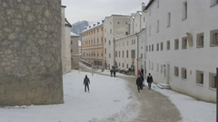 Stock Video Footage of People walking on an alley near old buildings in Salzburg