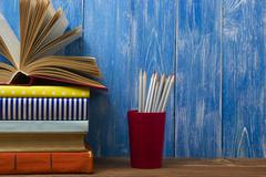 Open book, hardback books on wooden table. Back to school. Copy space for text Stock Photos