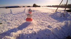 The many snowman on the snowfield Stock Footage