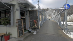 View of a cafe at the end of Mozart bridge in Salzburg Stock Footage