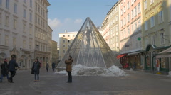 People walking by Saint Florian Fountain in Alter Markt in Salzburg Stock Footage