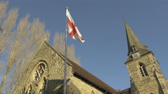 4K Low Angle Church Garden Clock Tower Stone Cross St George's Flag - stock footage