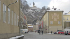 People walking on a street close to Saint Blaise Church in Salzburg Stock Footage