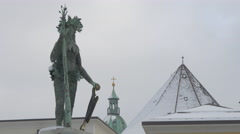View of a statue of a man holding Salzburg coat of arms and a rod in Salzburg Stock Footage