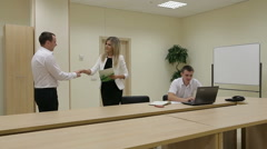 Businessman shaking hands to seal a deal with businesswoman. Stock Footage