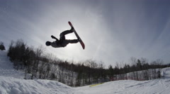 Extreme Sport Snowboarding Wide angle slow motion back flip Stock Footage