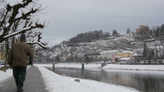 Stock Video Footage of People walking on Salzach river bank in Salzburg