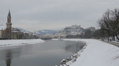 View of  Christuskirche and people walking on the river bank in Salzburg Stock Footage
