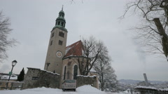 View of a car parked in front of Mulln Church in Salzburg Stock Footage