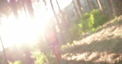 Woman trail runner in hoodie smiling while taking a break - stock footage