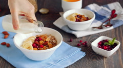 Close up of serving and consuming granola breakfast - stock footage