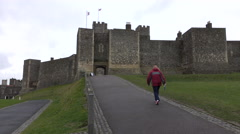 Dover Castle England woman walks to gate entrance 4K Stock Footage