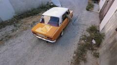 Soviet retro ZHIGULI lada first model moving through the old street - stock footage