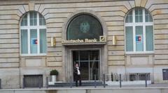 Man outside of Deutsche Bank branch, Frankfurt am Main, Germany Stock Footage