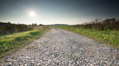 Dirt road sunset slider move timelapse Stock Footage