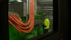 Bioreactor turbine - worker checks methane power generator exterior - stock footage