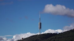 Barcelona Telecommunications Tower from distance, against blue sky Stock Footage
