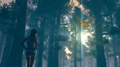 Figure in forest with a UAV drone watching, 3D animation Stock Footage