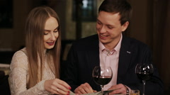 Young happy couple in restaurant reading menu Stock Footage