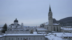 Stock Video Footage of Beautiful view of  Franziskanerkirche and Kollegienkirche in Salzburg