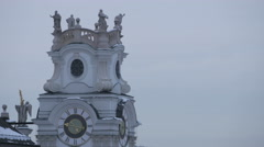 Close view of the clock tower of Kollegienkirche in Salzburg Stock Footage