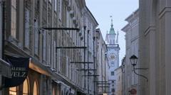 Old Town Hall clock tower seen from Sigmund-Haffner-Gasse in Salzburg - stock footage