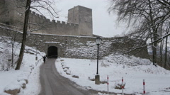 People walking on an alley and under an arch at Hohensalzburg Fortress, Salzburg Stock Footage
