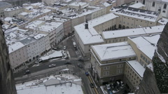 High angle view of people walking, biking and cars driving on a street, Salzburg Stock Footage