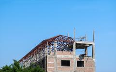 Stock Photo of Construction and Roof in progress to new house