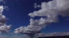 Cumulus clouds against deep blue sky, panning shot, Barcelona cloudscape. Stock Footage