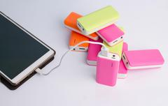 Tablet charging with Power bank Battery Stock Photos