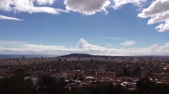 Bright clouds on blue sky, tilt down to aerial Barcelona panorama Stock Footage