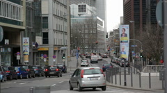 Cars drive down road in Frankfurt city center business metropolis, Germany Stock Footage
