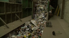 Household co-mingled mixed waste recycling plant - conveyor belt - stock footage