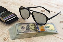 A bundle of money on the table Stock Photos