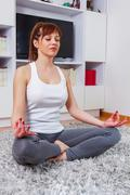 Fit Young Woman Relax at home. Yoga Meditation.Caucasian female relaxing at h - stock photo