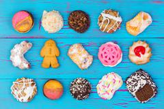 Assortment of colorful cookies on blue wood Stock Photos