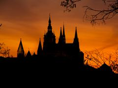 Prague Castle towers silhouette at sunset time - stock photo
