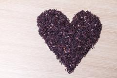 heart shape of rice berry grains - stock photo