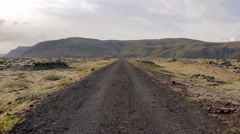 Lava field and dirt road in Iceland Stock Footage