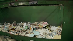Household domestic paper and cardboard recycling - side view - stock footage