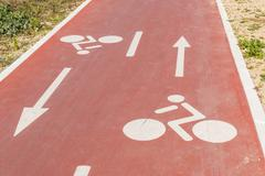 Traffic signs  drawn in the Cycleway - stock photo
