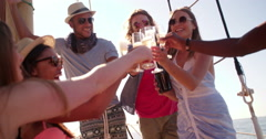 Multi ethnic girl at a party with friends and sunflare - stock footage