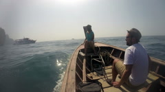 Boat with two passengers swinging on big waves Stock Footage