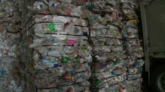 Plastics and plastic bottle recycling - baled for processing plant - stock footage