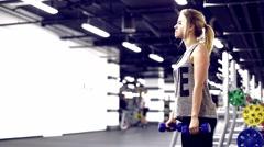 KYIV, UKRAINE - March 15, 2016: GYM Energym Blonde girl pumps biceps Stock Footage