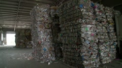 Plastics and plastic container waste recycling - pan of warehouse - stock footage