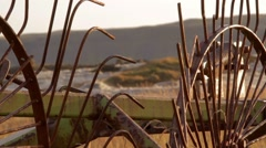 Old agricultural machinery on a background of mountain river in Iceland close-up Stock Footage