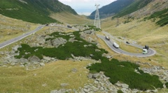 Aerial view on a queue of trucks on the most beautiful road in Europe Stock Footage