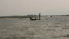 Fisher on boat in waters afar at Inle lake  in Myanmar Stock Footage